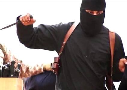 جلاد داعش زنده دستگیر شد + عکس